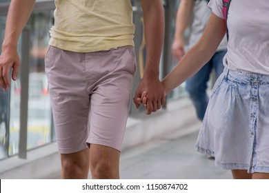 Love couple walking in the park holding hands. We will love and take care of you forever concept.