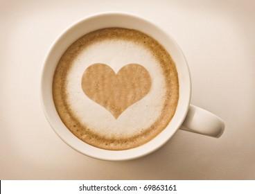love cup , heart drawing on latte art coffee