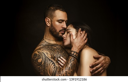 Love and desire. Latino man hugging adorable woman with love. Sensual couple in love. Erotic love of hispanic man and sexy woman.