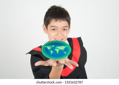 Love earth save our planet paper cut on boy's hand