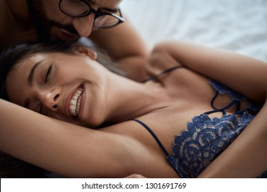 Love and eroticism in the bedroom- Tenderness in every touch. romantic lovers in bedroom.