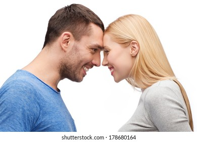 love and family concept - smiling couple looking at each other