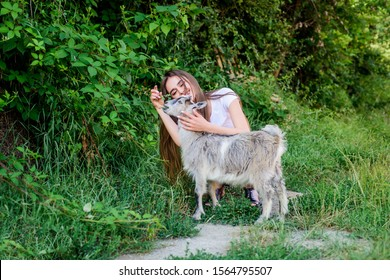 love. farm and farming concept. Animals are our friends. happy girl love goat. village weekend. summer day. Love and protect animals. contact zoo. veterinarian lamb goat. woman vet feeding goat.