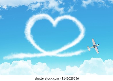 Love figurative heart from a white smoke trail light-engine airplane among the clouds