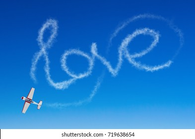 Love figurative inscription from a white smoke trail airplane