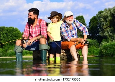 I love fishing. Fishing in river. Happy grandfather and grandson are fishing on the river. Three generations ages: grandfather, father and young teenager son
