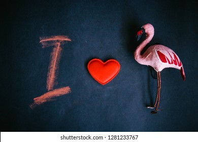 I love the Flamingo, the symbol of the heart of flamingos and the letter I on a dark background.