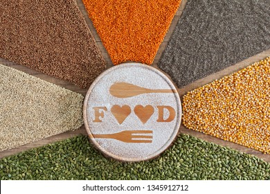Love food concept with colorful variety of grains and seeds on brown table