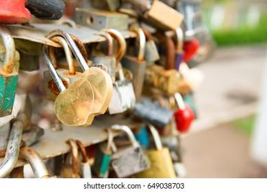 Love golden romance lock with heart shape on the bridge