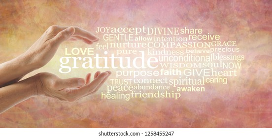 Love and Gratitude Word Cloud - female hands cupped around the word GRATITUDE and a relevant word cloud on a warm gold orange rustic background