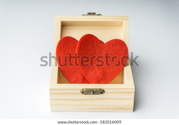 A love hand craft with small treasure chest box over white background.