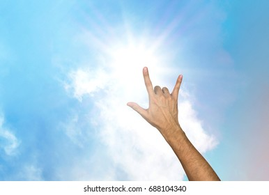 Love hand gesture with sky and cloud