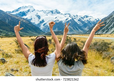 Love with hands in the fields with mountain and snow