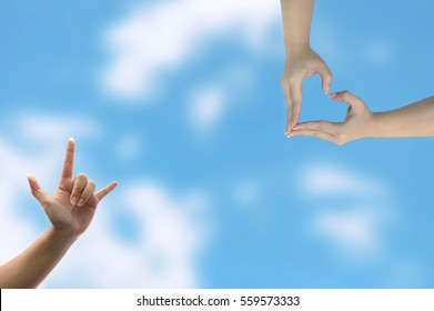 Love hands symbol  on the sky. Love/ National Friendship Day concept.