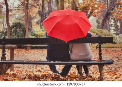 love, happy elderly couple in love, retired people enjoying romantic moment in autumn park, fall season