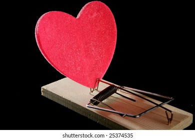 Love and health as a mouse trap. Metaphor with red candy heart