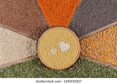 Love healthy food concept with diverse grains, seeds and various cereals in colorful radial stripes