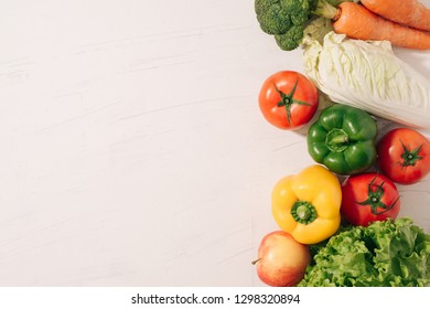 I love healthy food. Concept written with mix of vegetables on table