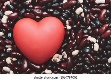 Love healthy food. vegetarian diet. Red heart on Legumes background. High protein vegan foods for muscle building.