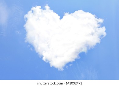 Love Heart from clouds with blue sky background