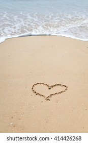 Love Heart drawn on sandy atlantic coast background