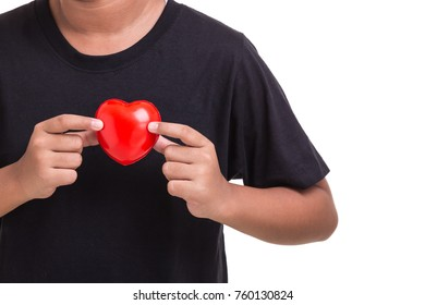 Love heart and healthcare concept : Woman holding red heart on her chest and heart position isolated on white background