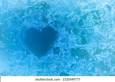 Love heart ice flowers frosted window pattern background. Christmas Valentines day romantic greeting card template