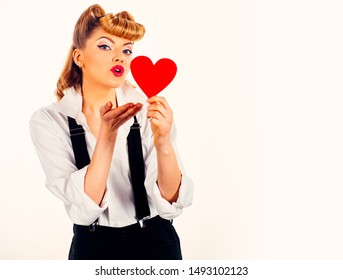 Love heart kiss. Woman in love. A young girl holds a red heart. Love concept. Girl on a white background. Valentine day.