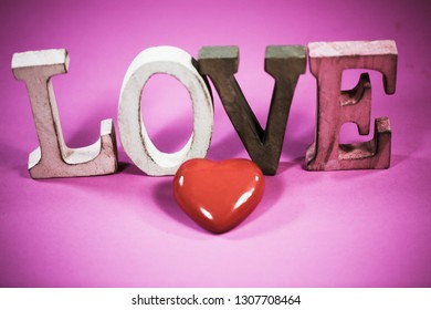 Love, with heart, pink background