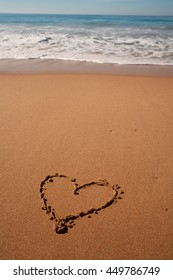 love heart sign draw on the beach