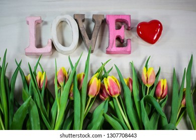 Love with heart and tulips, for Valentine's Day, birthday, card