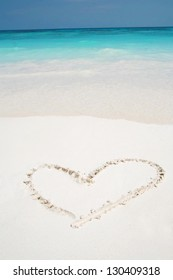 love hearts drawn in beach, beautiful sand surface background ocean and natural island