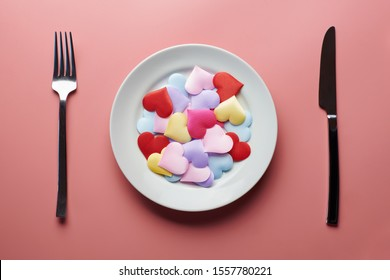 Love hearts in plate. Sex flirt concept. Fall in love in different partners. Pick a new girlfriend or boyfriend. Promiscuity and polygamy concept.