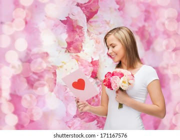love, holidays and happiness concept - smiling girl with postcard and bouquet of lowers