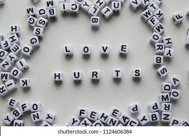 love hurts word written on cubes on white background. Creative text for your business.