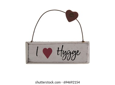 I Love HYGGE sign on a white background, Hygge is a Danish and Norwegian word which can be described as a quality of cosiness and comfortable conviviality that engenders a feeling of contentment.