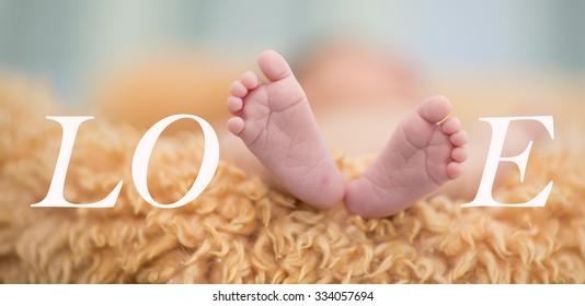 LOVE, infants feet, abstract.