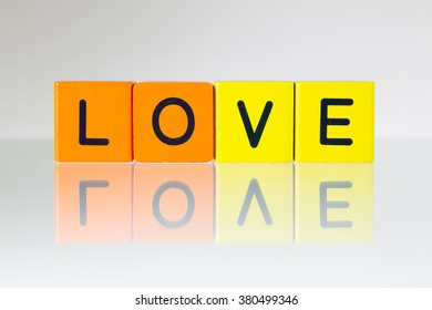 Love - an inscription from children's wooden blocks