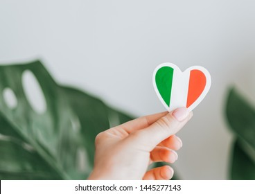Love Italy, hand holds heart emblem national flag colored. Flag of Italy with heart shape for Italian Republic Day or tourist concept