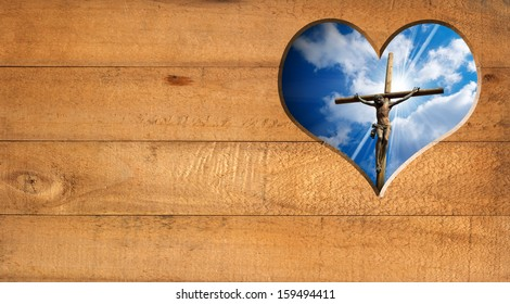 I Love Jesus - Crucifixion / Wooden wall with a hole in the shape of heart with Jesus crucified and blue sky with clouds