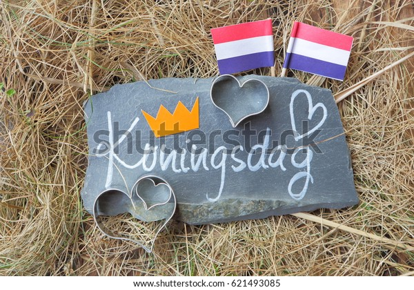 I love Kingsday in Dutch written on rock.