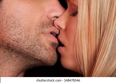 love kiss of young sexy heterosexual sensual couple