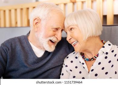 Love language. Adorable senior couple embracing and smiling
