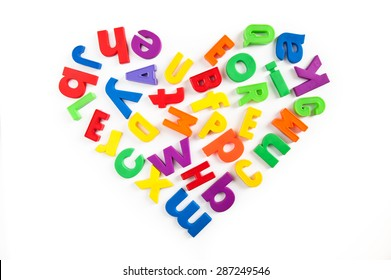 Love to learn. Heart shape made of colorful magnetic fridge letters.