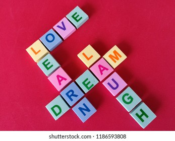 Love, learn,dream and laugh in crossword