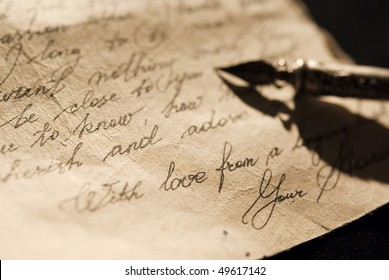 Love letter and antique quill on a black background