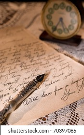 Love letter with antique quill on a tablecloth