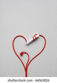 love letter: A stalk rolled up around a closed paper keeping its contents secret and drawing a red heart for valentine day