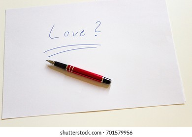 love letter writing essentials with red pen.