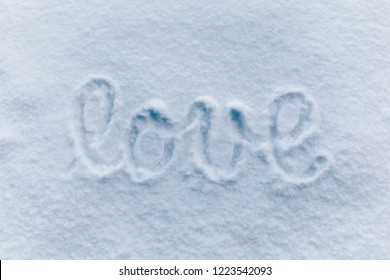 Love letters handwritten on sunny snow background.